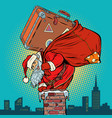 santa claus with a suitcase climbs into the vector image