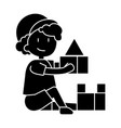 boy playing with toys box of bricks icon vector image