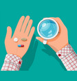 glass water pills capsules in hand vector image vector image