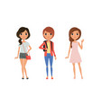 three girls dressed in trendy clothes standing vector image vector image