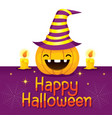 halloween pumpkin wearing hat with candles vector image