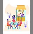 relaxed people sitting at tables at outdoor cafe vector image vector image