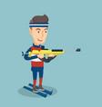 Cheerful biathlon runner aiming at the target