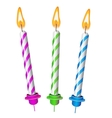 Three festive burning colored candles isolated vector image