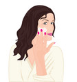 a girl treating her face vector image
