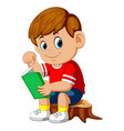 cute boy reading book on the stump vector image
