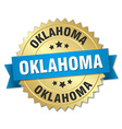 Oklahoma round golden badge with blue ribbon vector image vector image