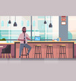 businessman sitting on chair at bar counter vector image