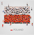 large group of people in the poland flag shape vector image vector image