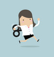 businesswoman running with wind-up key vector image
