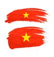 grunge brush stroke with vietnam national flag on vector image