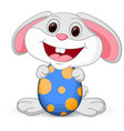 easter cute bunny holds egg vector image vector image