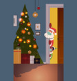 santa claus with elf peeking out from behind door vector image vector image