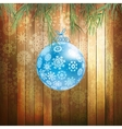 Christmas ball on a wooden background EPS 10 vector image