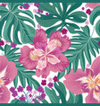 tropcal flowers and palm leaves seamless pattern vector image