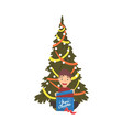 cute boy sitting next to christmas tree with gift vector image vector image