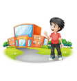 A boy standing in front of the school vector image