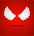 artificial white paper wings on red background vector image vector image