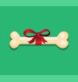 bone with red ribbon for dog pets reward symbol vector image vector image
