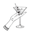 martini with eyeballs cocktail in hand witch vector image vector image