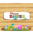 The Easter bunny holding a basket of Easter eggs vector image vector image