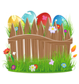 Easter eggs with grass and fence vector image vector image