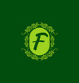 green f initial letter in classic frame vector image vector image
