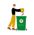 young man throwing organic waste into garbage vector image