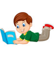 cartoon boy laying down and reading a book vector image vector image