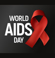 isolated red ribbon with white text world aids day vector image