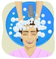 young man getting his hair washed in hair salon vector image vector image