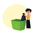 boy putting garbage bag into trash bin waste vector image vector image