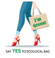 woman legs and ecological shopping bag vector image