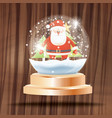 Christmas crystal ball with snow and santa claus