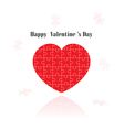 red puzzle heart shape vector image