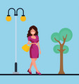 a beautiful girl is holding purse in her hands vector image