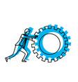 businessman pushing a big gear cogwheel blue vector image vector image