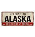 welcome to alaska vintage rusty metal plate vector image vector image