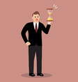 Businessman holding sandglass vector image vector image