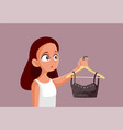 teen girl holding a crop top on a clothing hanger vector image