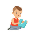 flat character of preschool boy sitting on the vector image vector image