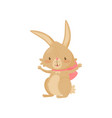 joyful bunny with bright pink bow on neck brown vector image