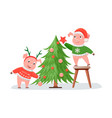 pigs in knitted sweaters decorating christmas tree vector image vector image