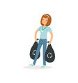 young girl carrying two black bags with rubbish vector image vector image