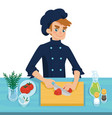 happy young cook slicing tomato on chopping board vector image vector image