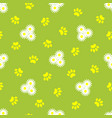 animal paw prints and daisies seamless pattern vector image vector image