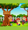 children reading book and relax near the tree vector image vector image