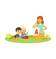 woman with toddlers sitting on round carpet vector image vector image
