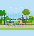 couple riding bicycles in public park vector image
