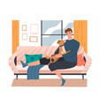 young man playing with his dog on a sofa vector image vector image